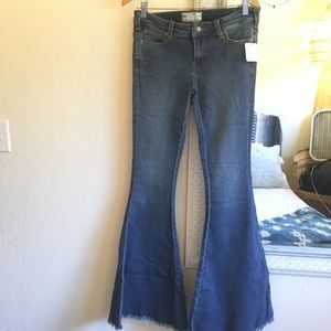 NWT RARE Free People distressed super flare jeans